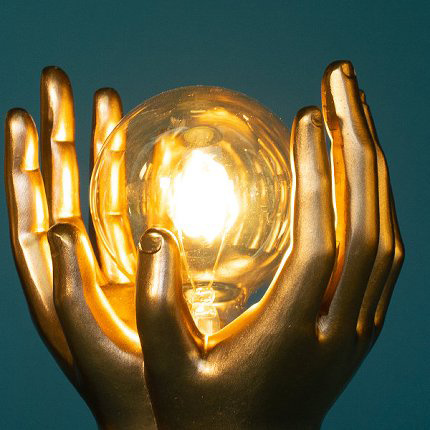 Gold hands table lamp