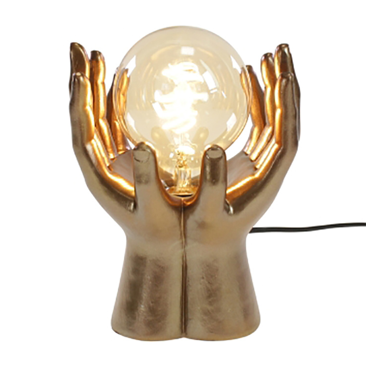 Gouden handen tafellamp