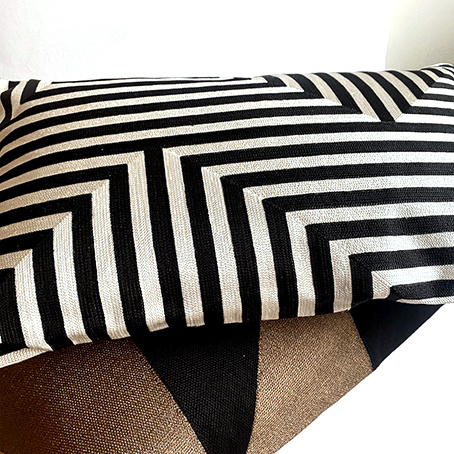 Rectangular cushion with black and white pattern