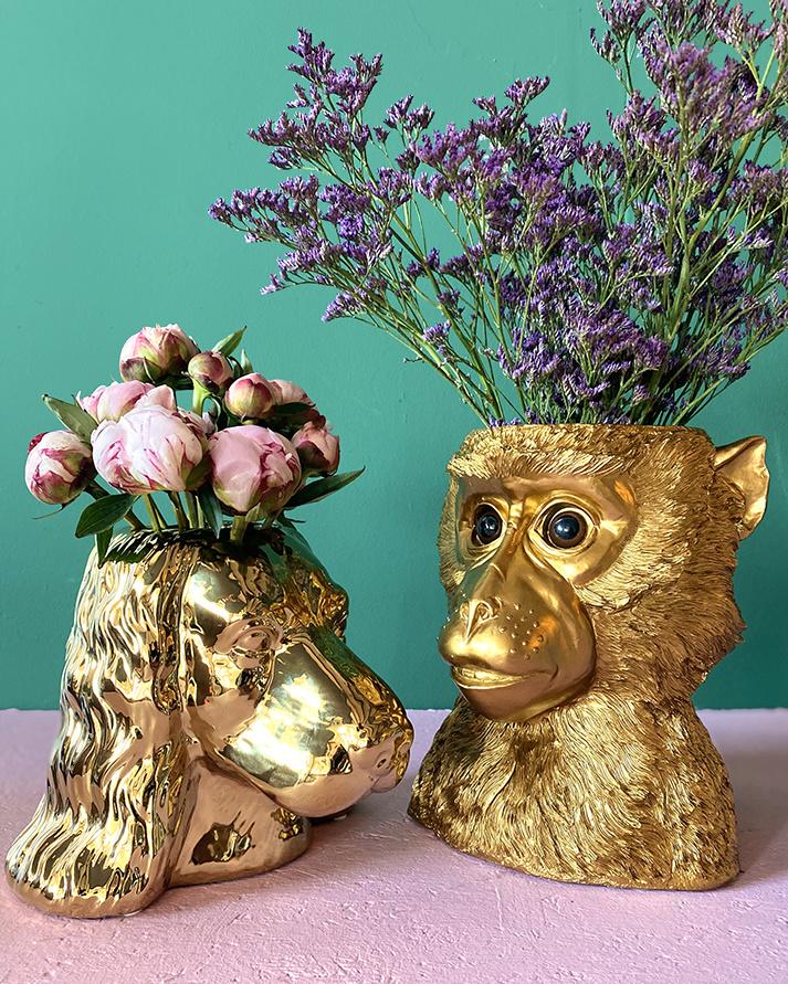 Gouden aap bloempot