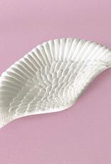 Wit bordje in de vorm van een vleugel