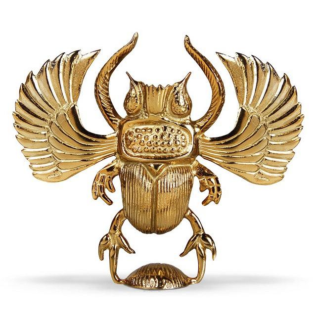Gouden scarabee kandelaar