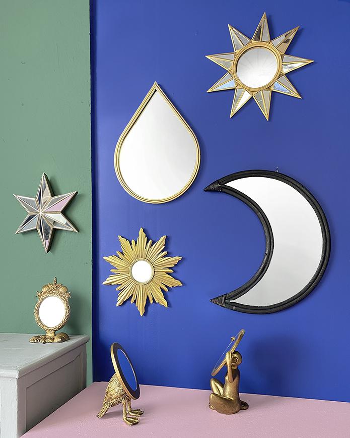 Black half moon rattan mirror