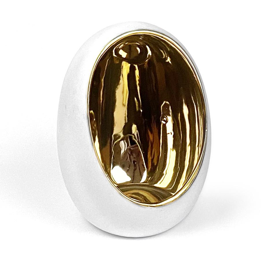 White ceramic egg shaped tealight holder with gold inside