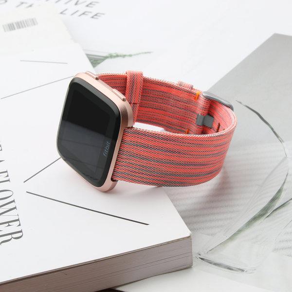 123Watches.nl Fitbit versa nylon gesp band - orange striped