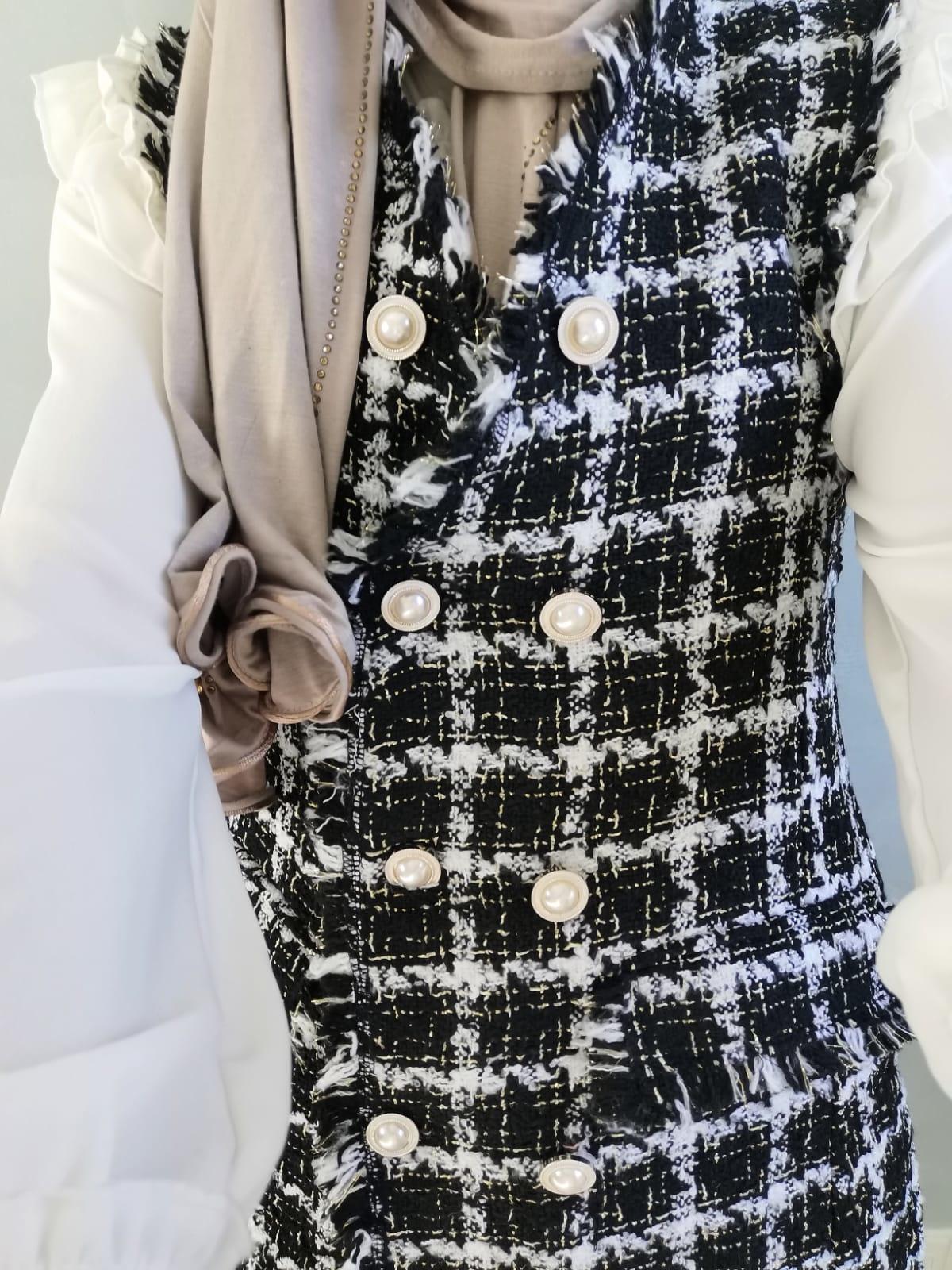 Mouwloze tweed jasje blocked zwart