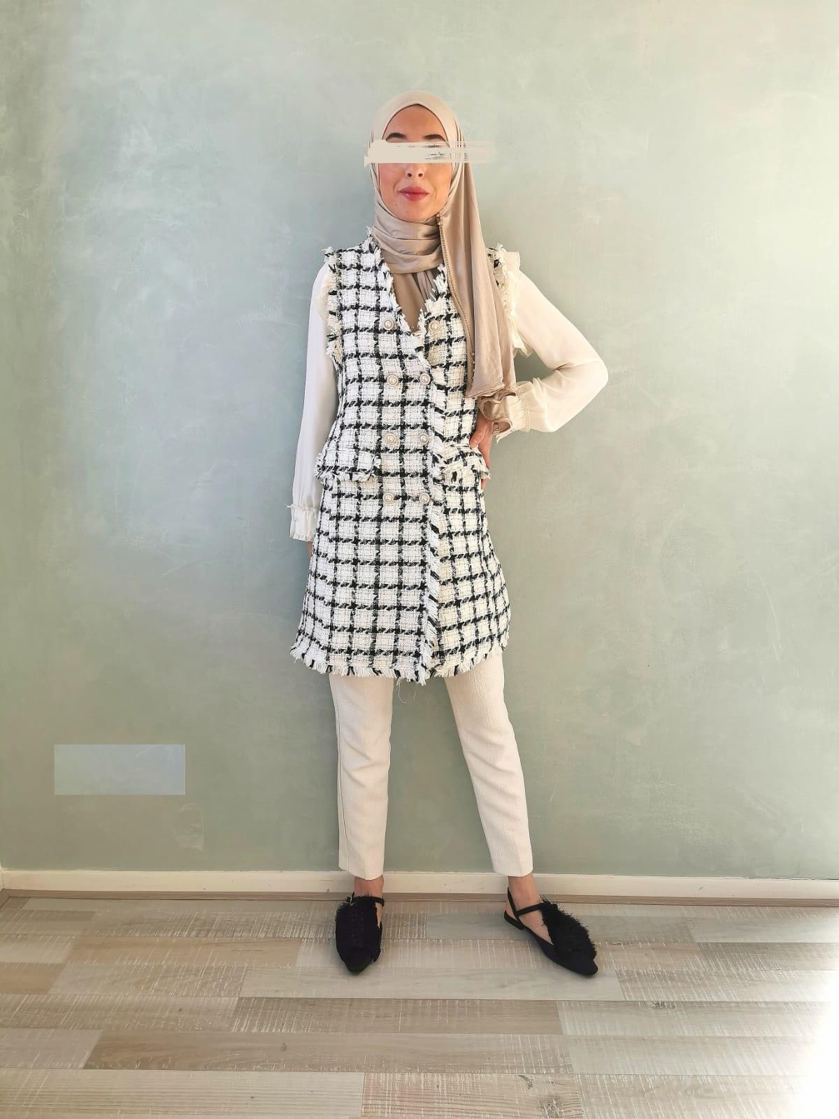 Mouwloze tweed jasje blocked wit