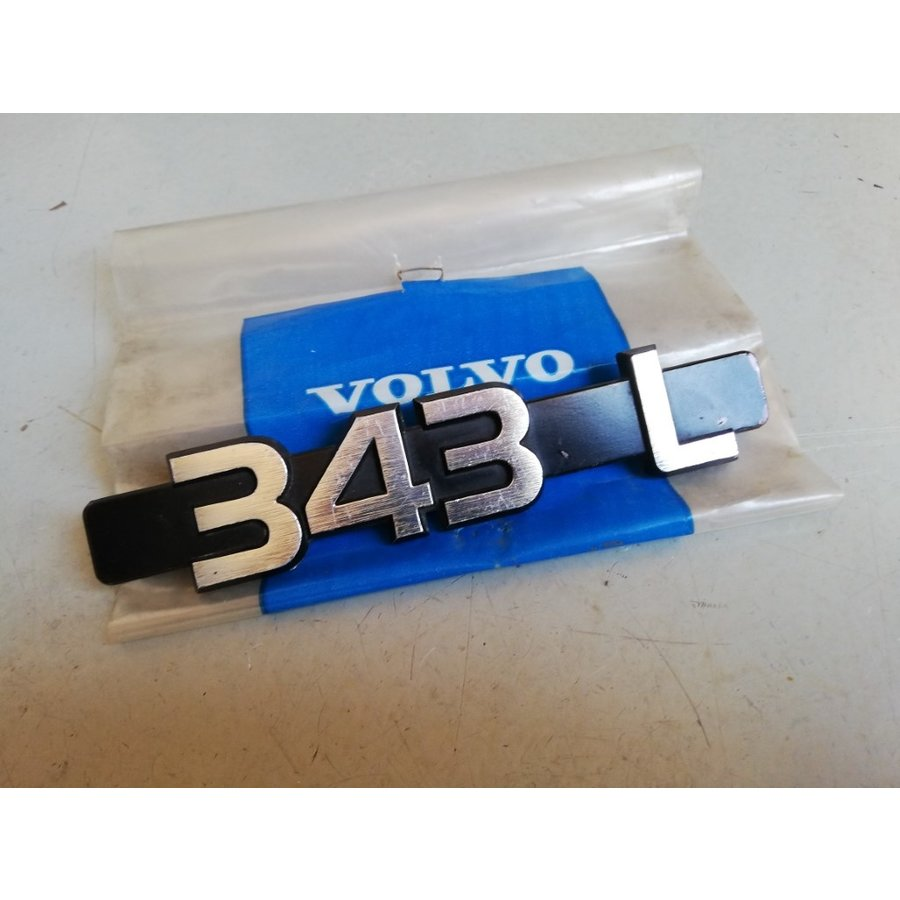 Lettering emblem on the rear of the trunk 3282077-1 NOS Volvo 343