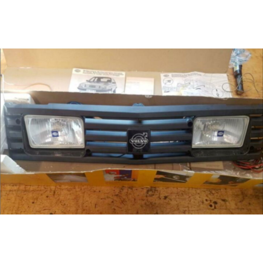 Grille with high-beam headlamps Hella 1FB-004-630-811 NOS Volvo 340, 360