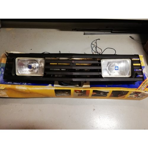 Grille with spotlights Hella 1FB-004-630-811 uses Volvo 340, 360