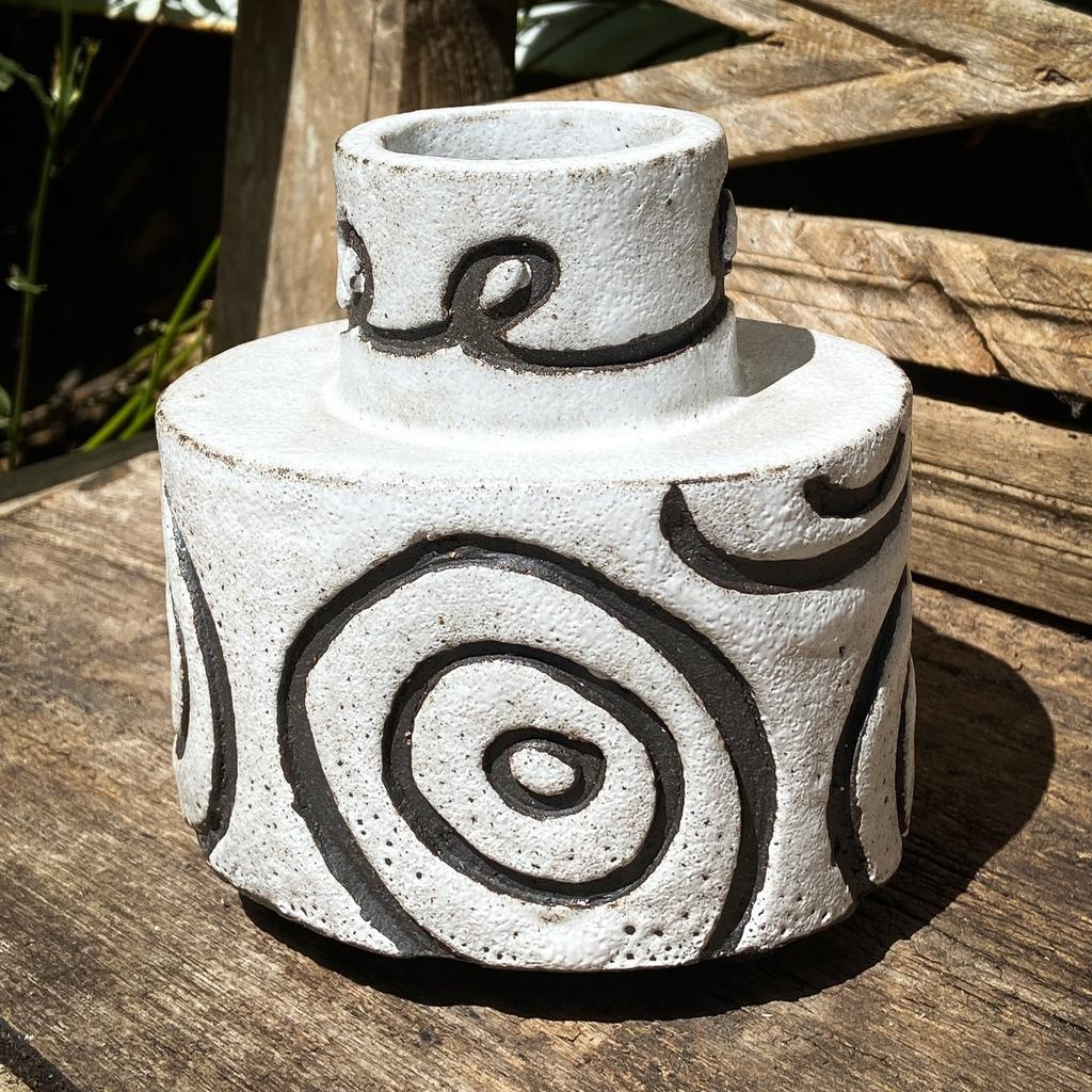 Handbuilt  embossed stoneware oval vase in black clay with white stone glaze 170x110mm