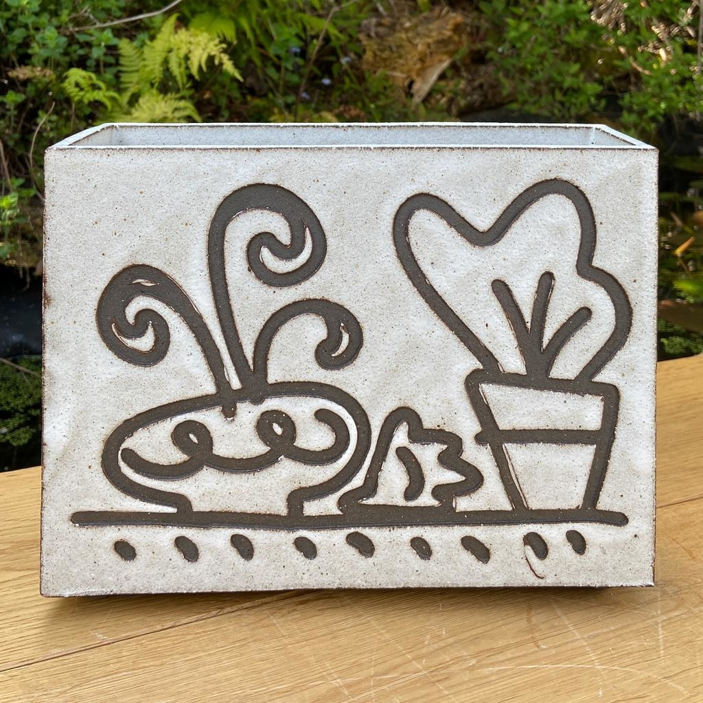 Handbuilt  embossed stoneware box vase in black clay with white stone glaze 190x250mm