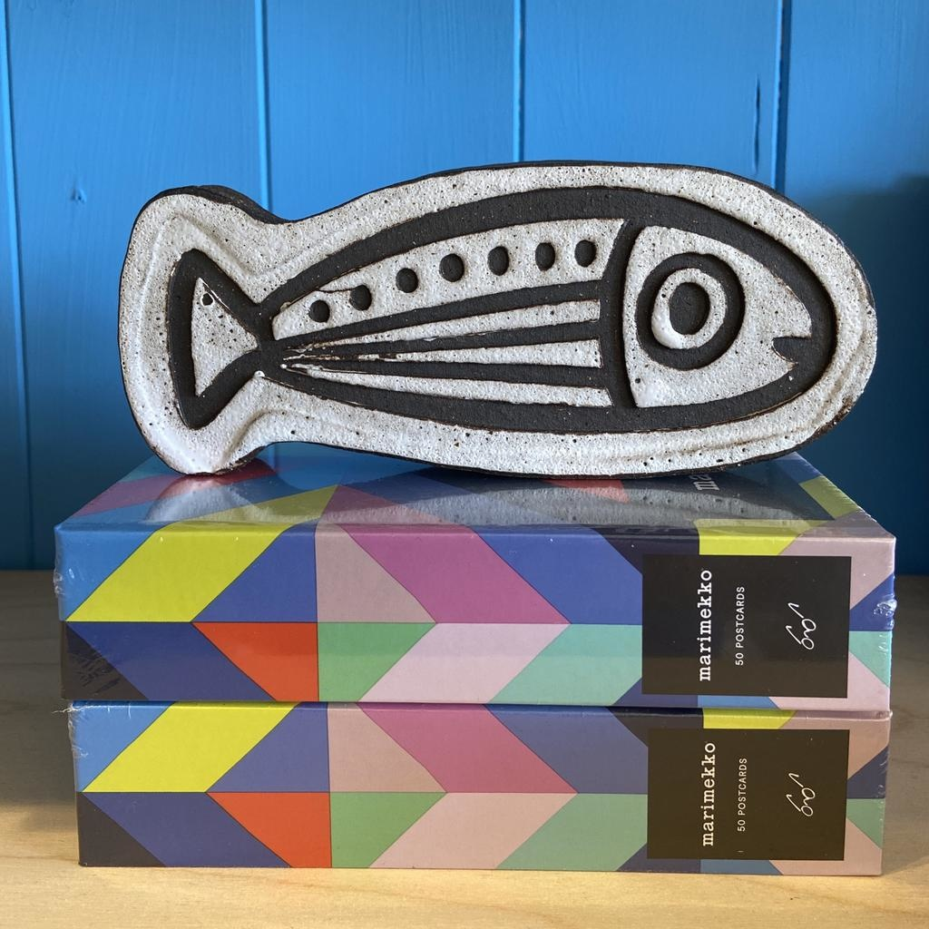 Handbuilt  embossed stoneware fish paperweight in black clay with white stone glaze 170x80mm