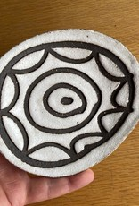 Handbuilt embossed stoneware sweetdish in black clay with white stone glaze. Flower shape. 160 x 140 mm approx.