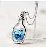 NIEUW ketting zilverkleur fles met blauw strass hart