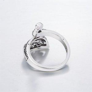 Janshop Open ring verstelbaar Pauwen zilveren kleur