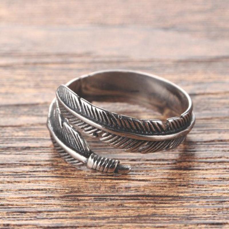 Janshop Open ring verstelbaar veren zilveren kleur