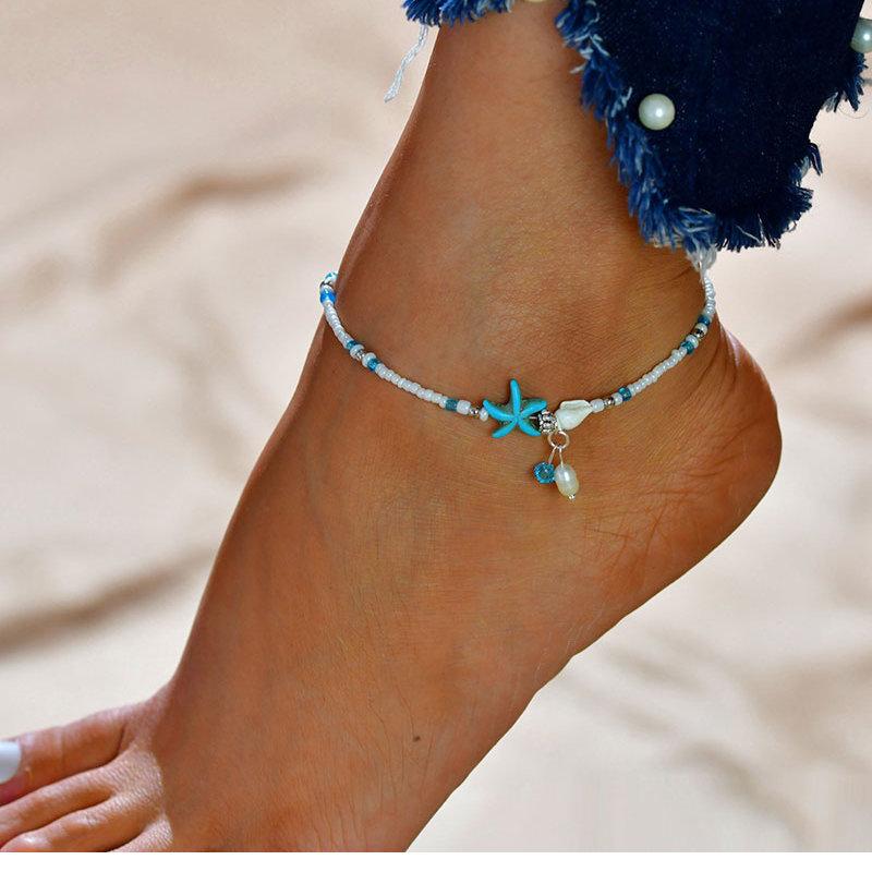 Janshop Enkelbandje ibiza schelpje en zeester turquoise kleur