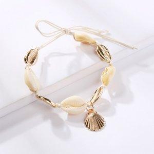 Janshop Enkelbandje natuurlijke zee schelpjes met gouden schelpen bedels