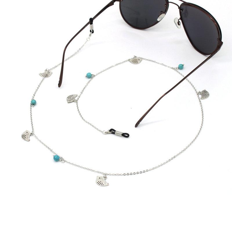 Brillenkoord hip Ibiza zilveren vogeltjes met turkoois kraaltjes