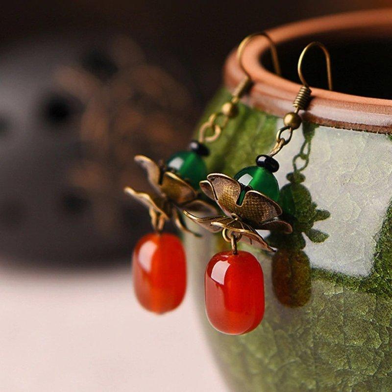 Janshop Koperen bloemen oorbellen groen met rood agaat