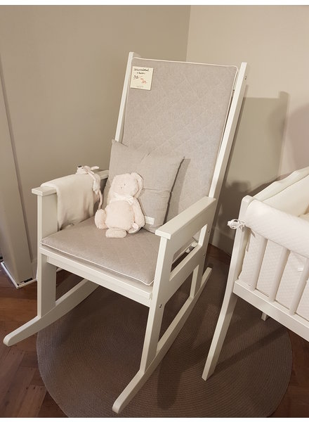VOX Rocking chair with gray seat.
