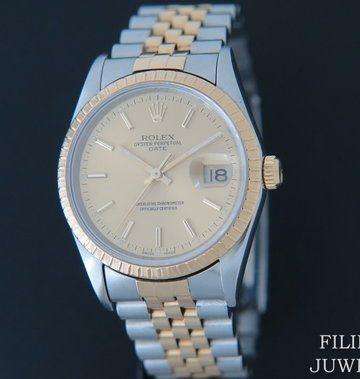 Rolex  Date Gold/Steel 15233 Champagne Dial