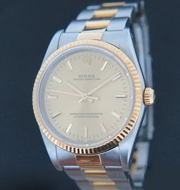 Rolex  Oyster Perpetual Gold/Steel 14233 Champagne Dial