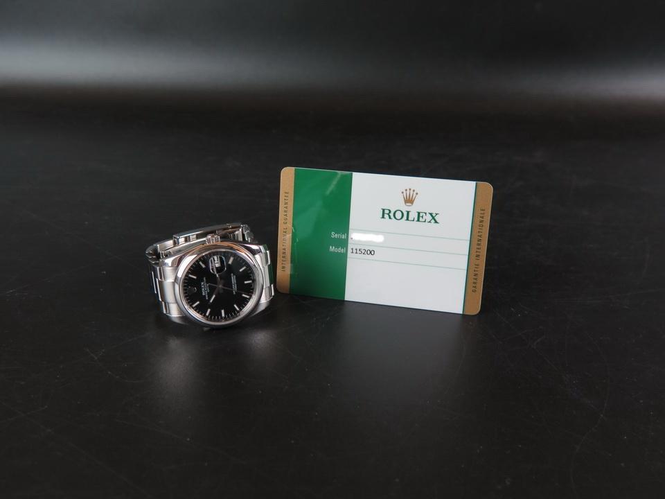 Rolex  Rolex Date Black Dial 115200