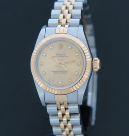 Rolex  Oyster Perpetual Lady Champagne Diamond Dial 67193
