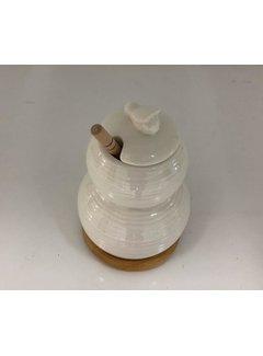 Porceleinen honingpot met bamboe onderzetter en bamboe honinglepel