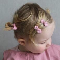 Piccoli fiocchi di capelli