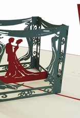 Bridal pair inside a pavilion