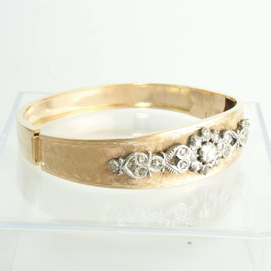Occasion 14 krt. geel gouden slavenarmband met Diamant