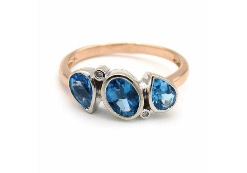 18 krt. gouden ring met briljant en blauwe zirkoon