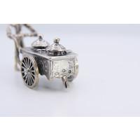 Zilveren miniatuur ijscoman