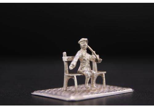 Occasion zilver miniatuur man op bankje 18.5gr BA.RR