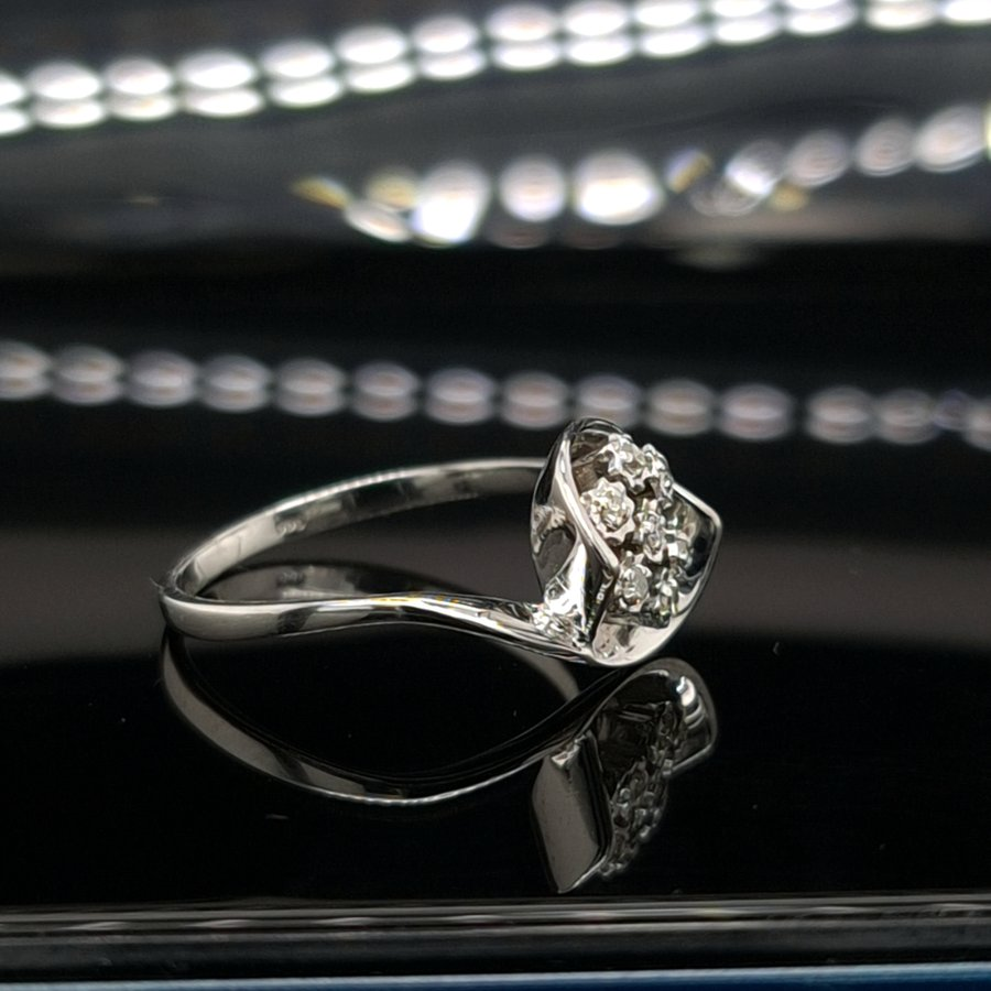 Occasion 14 karaat wit gouden ring 0.06 krt briljanten  1.5 gram  maat 16,5