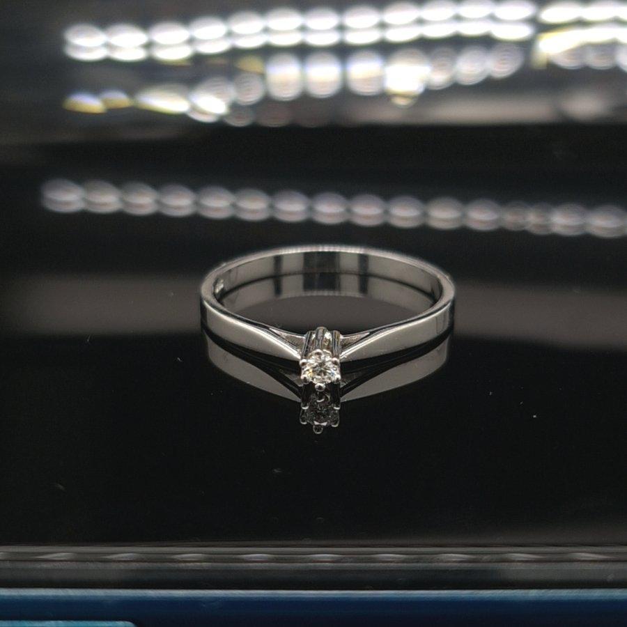 Occasion 14 karaat wit gouden ring 0.04 krt briljant 1.4 gram maat 17