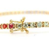 18 Karaat geel gouden armband met gekleurde saffier 8.10 krt 11.9 gram