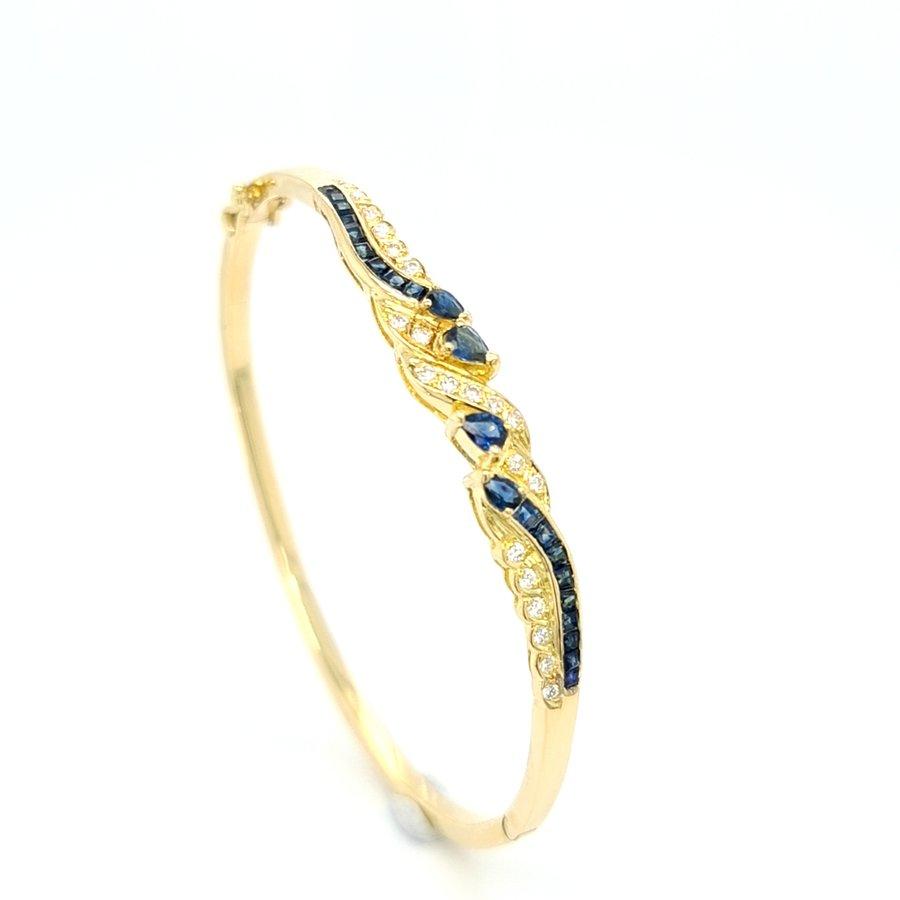 Occasion 18 karaat geel gouden armband briljanten/ saffier
