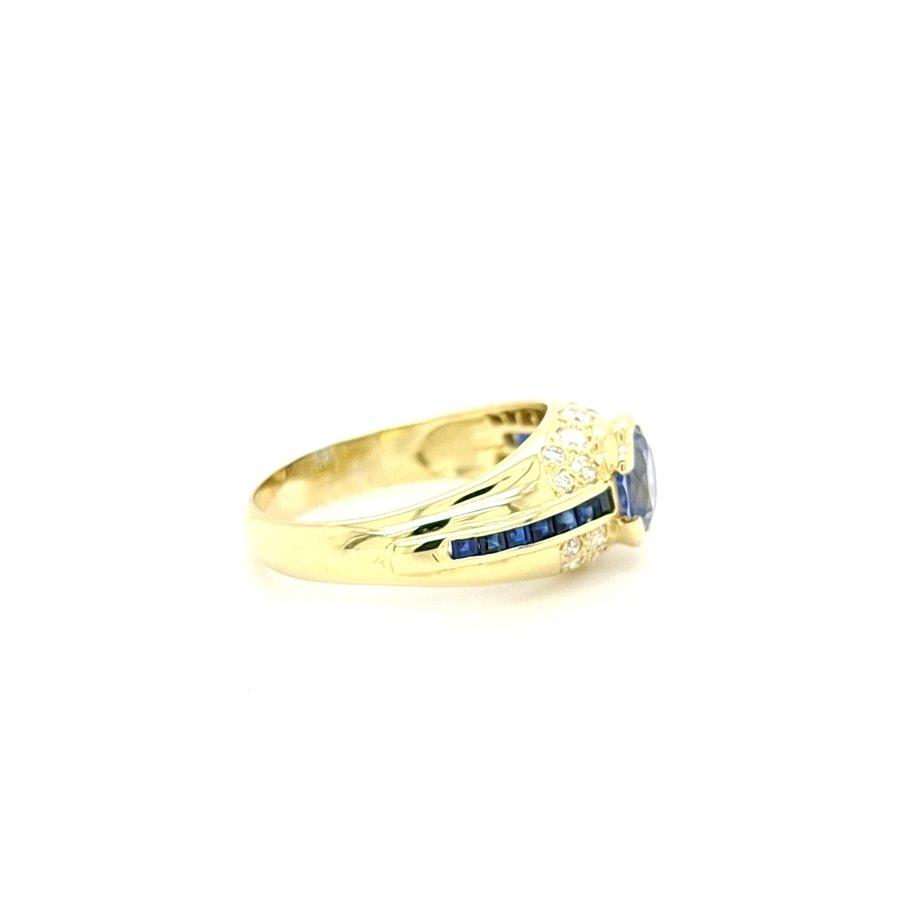 Occasion 14 karaat geel gouden ring briljant/saffier
