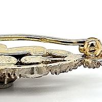 Occasion 14 krt. met zilver gecombineerde broche en roosgeslepen diamanten