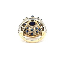 Occasion 14 krt. geelgouden en zilveren ring met saffieren en diamanten