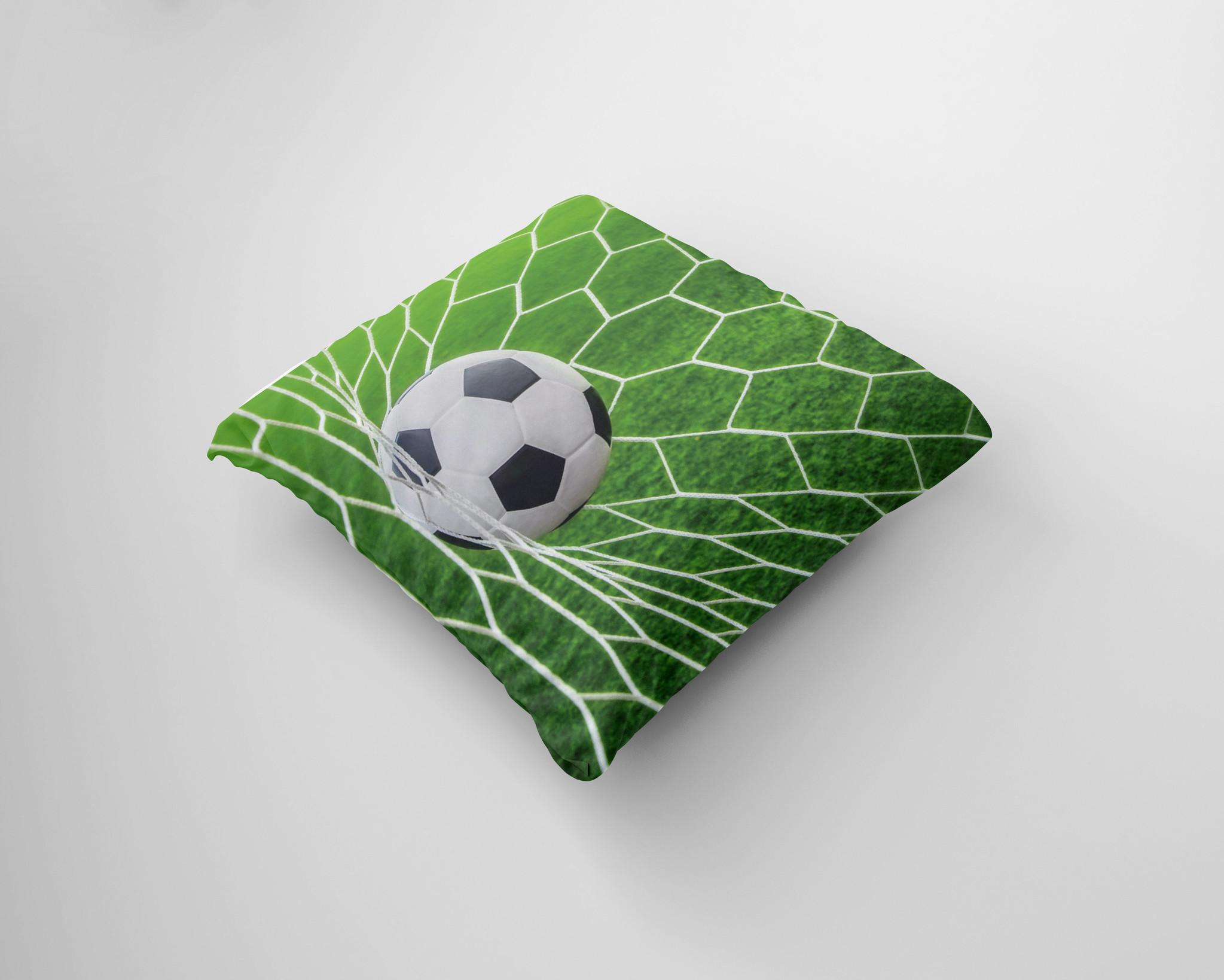 Kussen voetbal in net groen