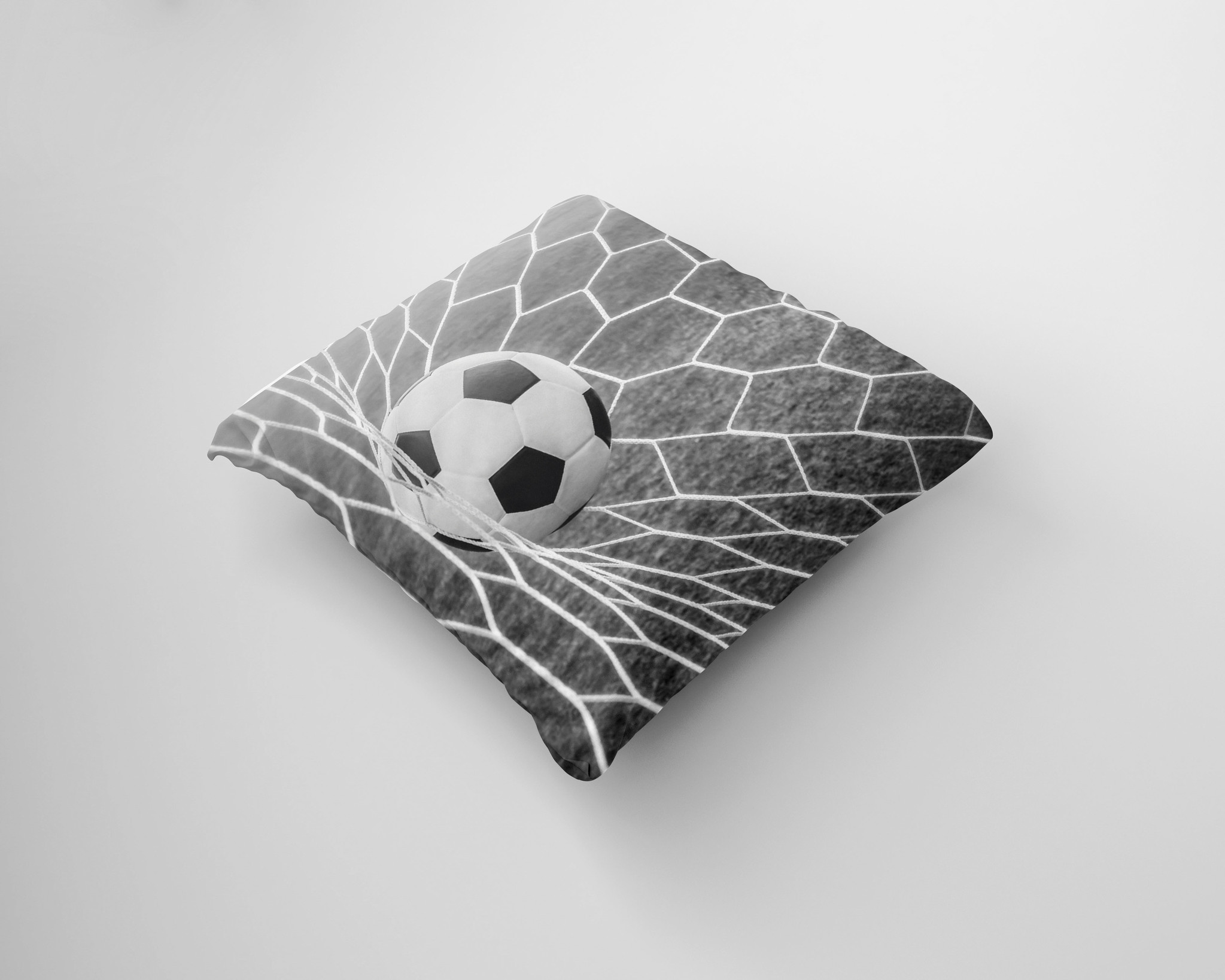 Kussen voetbal in net zwart/wit