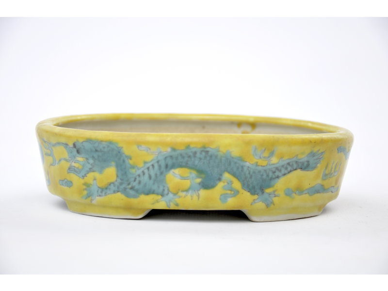 Oval hand-painted yellow glazed  pot - 150 x 112 x 40 mm