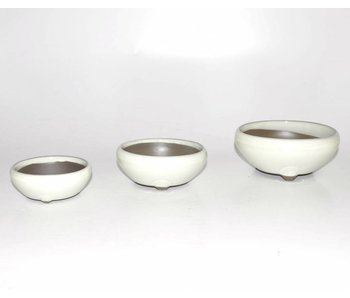 Set of three white pots