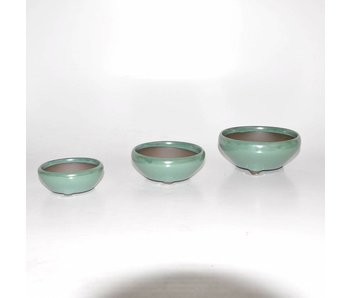 Set of three green pots