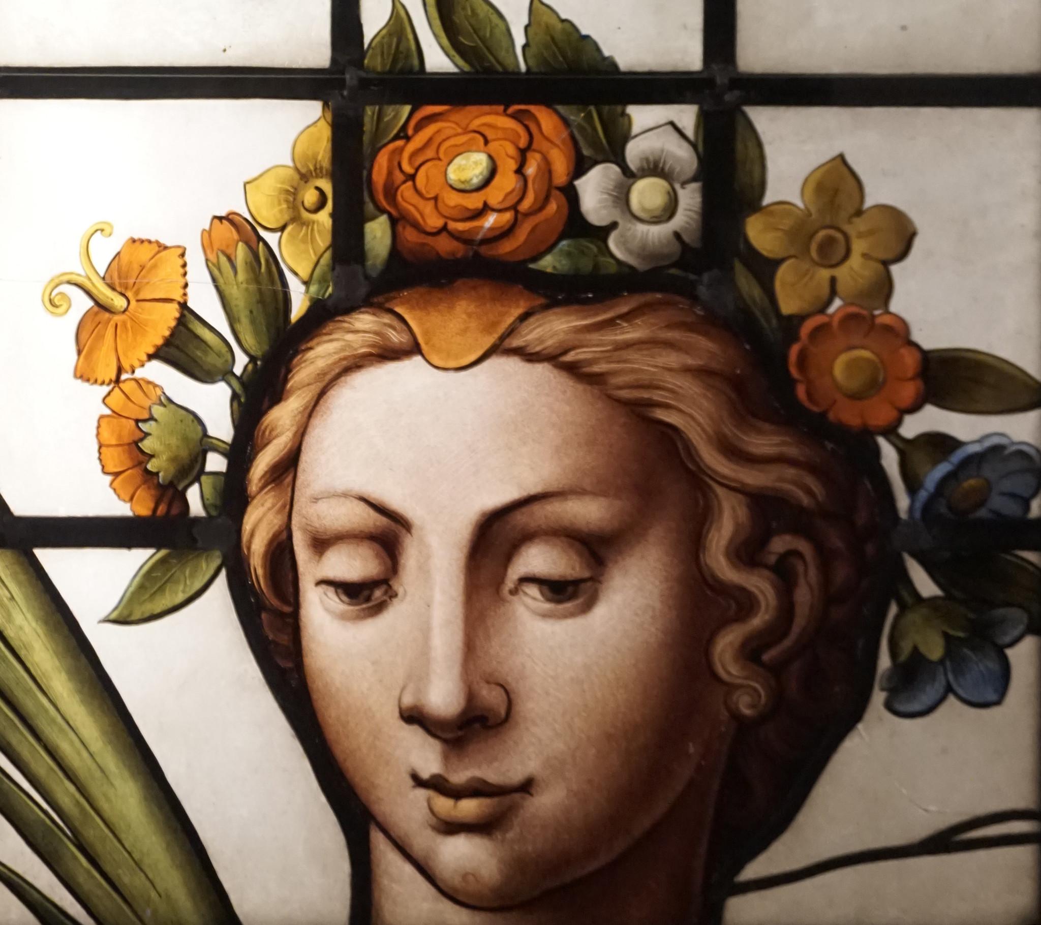glas beschilderd gezicht op tas Manichel